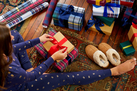 Girl in Southern Tide Pajamas wrapping Gifts