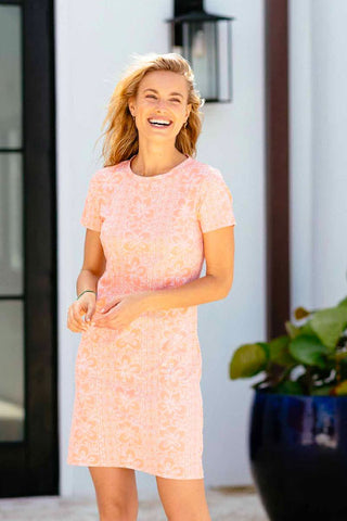 woman wearing a pink printed short sleeve dress as a bridal shower look