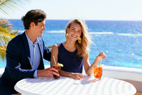 couple sitting with drinks at a beach resort