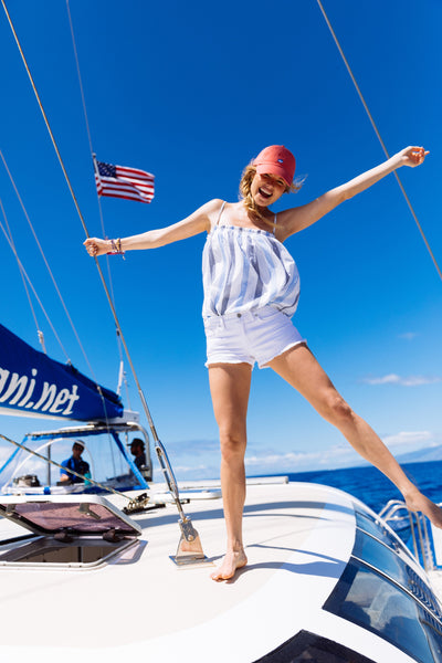 girl on boat 4th of july with flag