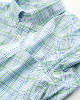 The front view of the Men's Green Abound Plaid Intercoastal Performance Sport Shirt by Southern Tide