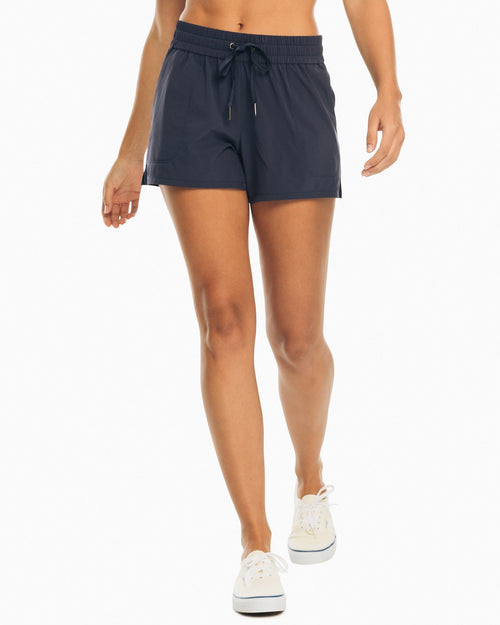 The front view of the Women's Navy Coastal Performance Solid Short by Southern Tide