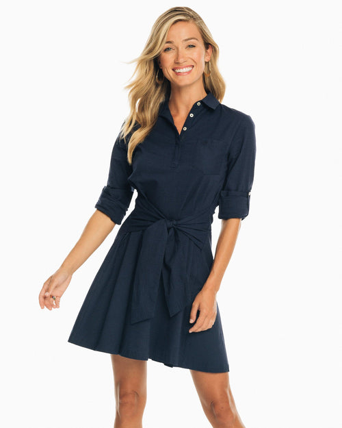 The front view of the Women's Navy Aliyah Tie Waist Seersucker Shirt Dress by Southern Tide