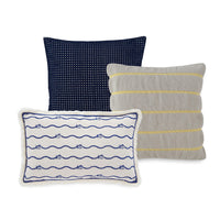 The front view of the Bayside Navy Eyelet Throw Pillow by Southern Tide