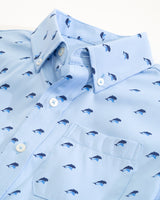 The flat view of the Kid's Light Blue  Dolphin Intercoastal Performance Short Sleeve Button Down Shirt by Southern Tide