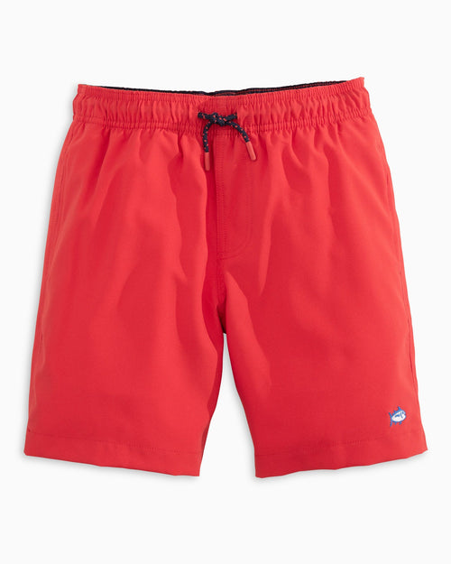 The front view of the Kid's Red Solid Swim Trunks by Southern Tide