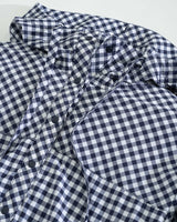 The front view of the Women's Navy Calie Gingham Lightweight Popover by Southern Tide