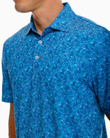 The front view of the Men's Driver Banana Leaf Print Performance Polo Shirt by Southern Tide
