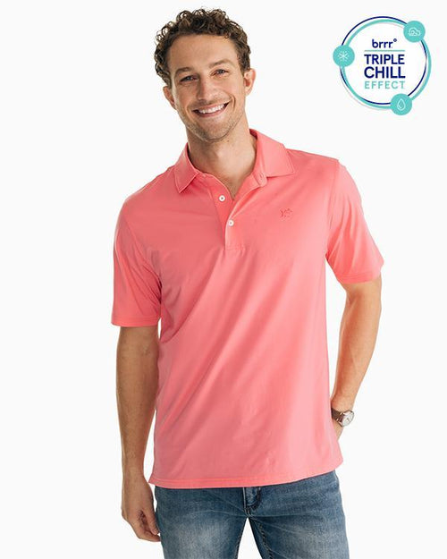 The front view of the Men's Pink Driver brrr® Performance Polo Shirt by Southern Tide