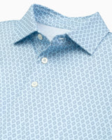 The front view of the Men's Blue Driver Diamond Print Performance Polo by Southern Tide