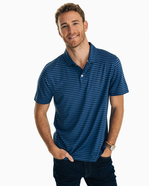 The front view of the Men's Navy First Mate Striped Performance Polo Shirt by Southern Tide