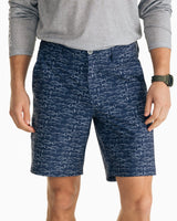 The front view of the Men's Navy T3 9 Inch Fish Print Gulf Short by Southern Tide