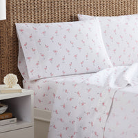 The lifestyle view of the Flamingo Printed Sheet Set by Southern Tide