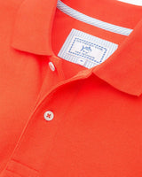 The front view of the Men's Orange Auburn Tigers Pique Polo Shirt by Southern Tide