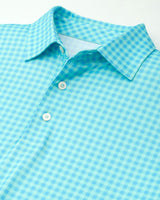 The front view of the Men's Blue Tile Gingham Driver Performance Polo Shirt by Southern Tide