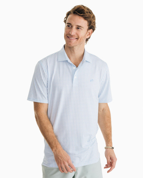 The front view of the Men's Light Blue Driver Gingham Performance Polo Shirt by Southern Tide