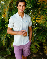 The front view of the Men's Orange Heather Stripe T3 9 Inch Gulf Short by Southern Tide