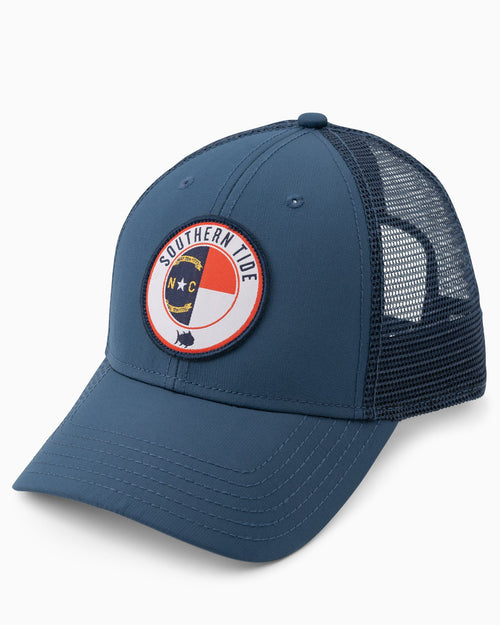The front view of the Men's North Carolina Patch Performance Trucker Hat by Southern Tide