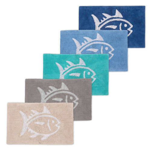 The stack view of the Reversible Skipjack Bath Rug by Southern Tide