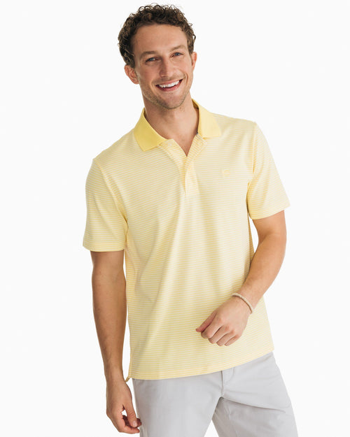 The front view of the Men's Yellow Roster Striped Performance Polo Shirt by Southern Tide