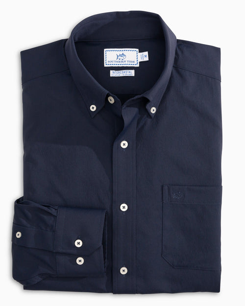 The front view of the Men's Navy Silent Night Intercoastal Performance Sport Shirt by Southern Tide