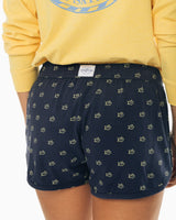The front view of the Women's Navy Skipjack Printed Lounge Short by Southern Tide