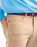 The front view of the Men's Khaki Intercoastal Performance Pant by Southern Tide