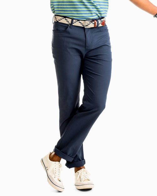 The front view of the Men's Navy Intercoastal Performance Pant by Southern Tide
