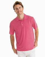 The front view of the Men's Pink Driver Striped brrr Performance Polo Shirt by Southern Tide