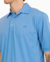 The front view of the Men's Blue Driver Striped brrr Performance Polo Shirt by Southern Tide
