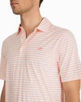 The front view of the Men's Orange Driver Striped brrr® Performance Polo Shirt by Southern Tide