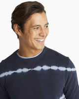 The front view of the Men's Navy Tie Dye Striped Upper Deck Pullover Sweater by Southern Tide