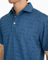 The front view of the Men's Navy Driver Wave Print Performance Polo Shirt by Southern Tide