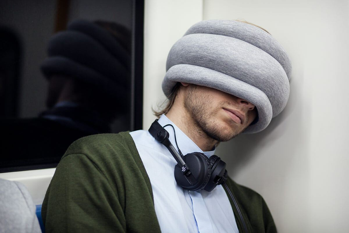 ostrichpillow_light_multiuse-travel-pillow_subway_man_midnight-grey