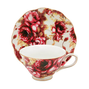 Antique Rose Tea Cup Saucer Candle with hidden Gemstone.