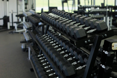 York Barbell Commercial Rubber Hex Dumbbells on rack