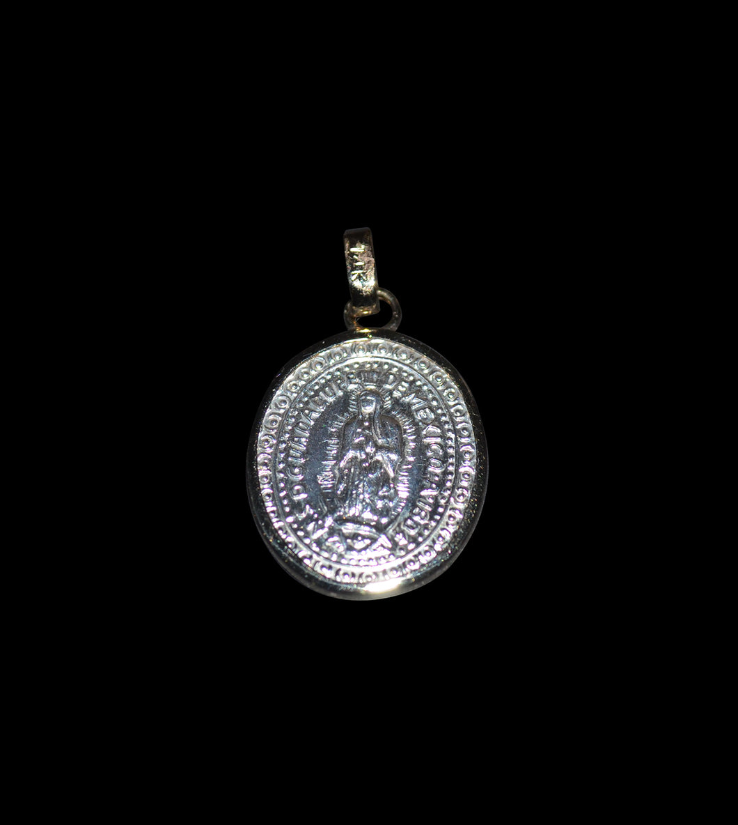 Small silver made with oval shape Guadalupe Madonna medallion