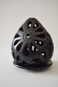 Carved egg shaped luminaire with base