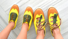 Mom and daughter pineapple style shoes.