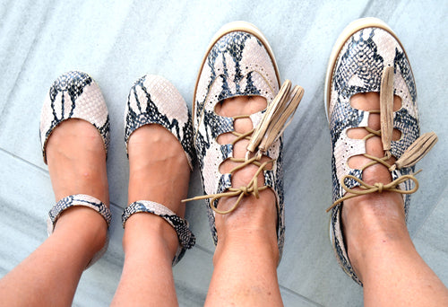 Mom and daughter nude snake print shoes.