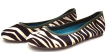 Mom and daughter zebra print shoes.