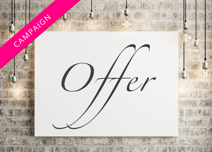Sign on wall with the word 'offer', surrounded by hanging lights