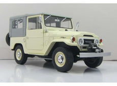 1967 Toyota Landcruiser FJ40 with closed soft top. beige/grey