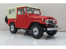 1967 Toyota Landcruiser FJ40 with closed soft top. red/beige