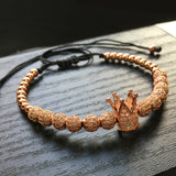 Men's fashion, rose gold, zoomed in detailed 1King Golden grown, bracelet.