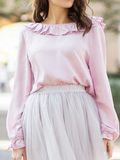 THE BLOUSE WITH FRILLS