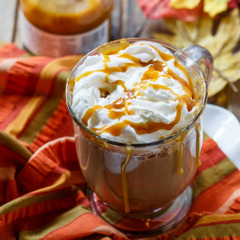 Salted Caramel Latte in a glass with whipped cream and caramel on top