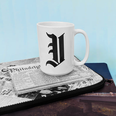 Inquirer 15 oz. Mug on Archival Inquirer Journal and Archival Inquirer Laptop Sleeve