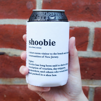 """Shoobie"" Can Cooler - Definition against Brick Wall"