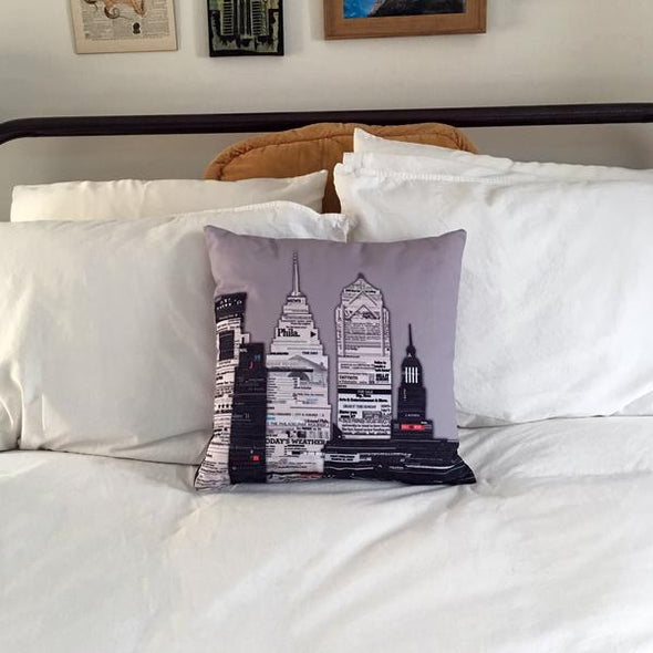 Philly Newsprint Throw Pillow on White Bedspread